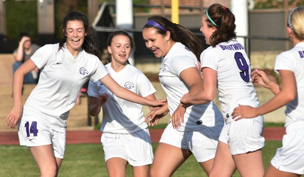 The Eagles celebrate Maggie Callihan's goal for a 2-0 lead over Bayless. They are (from left) Amanda Ingersoll, Elle Curran, Callihan, Gabby Gombas.