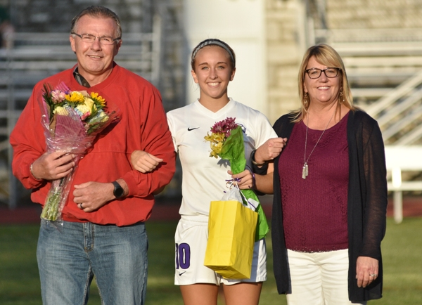 For senior night, Kate Gilmore is honored along with her parents, Jerry and Mary Ellen Gilmore.