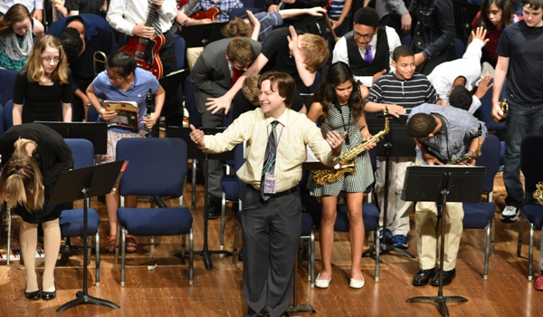 "Grant Krener and the middle school bands take a bow after playing ""Come Together"" by the Beatles."