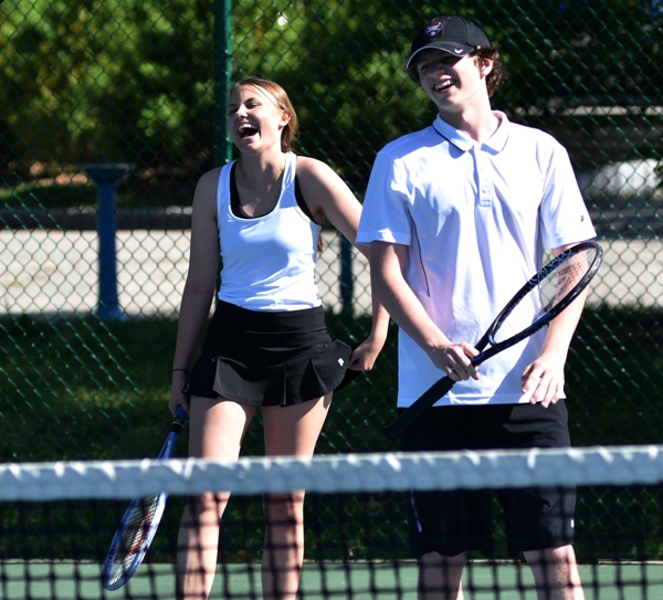 Doubles partners Jenny Laseter and Hunter Brown-Scott laugh at a comment by a St. Mary's player.