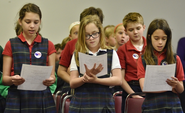 """Students join others in singing """"God Bless America."""""""
