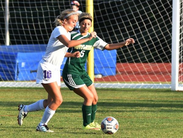Kate Gilmore fights a Bayless player for the ball.