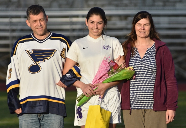 Megan Shipley with her parents, Derek Shipley and Julie Newport.
