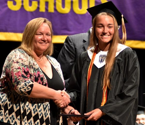 Sophia Rivera receives her high school diploma from her mother, Michelle Hassemer, Saturday evening at the BHS commencement.