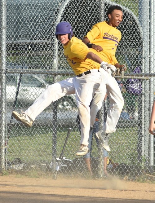 Celebrating from John Bischoff (left) and Butters Jones as the Eagles take an 8-3 lead in the eighth.