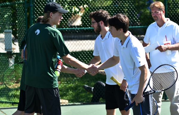 Noah Lee (right) and his doubles teammate Alex Riedel shakes hands with the No. 1 doubles team from St. Mary's.