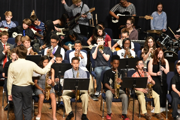 "Grant Krener directs the combined middle school bands in ""Blues in Bb."""