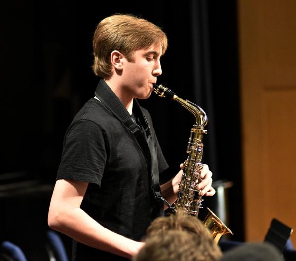 """Ben Greiner plays an alto saxophone solo during """"Cantaloupe Island."""""""