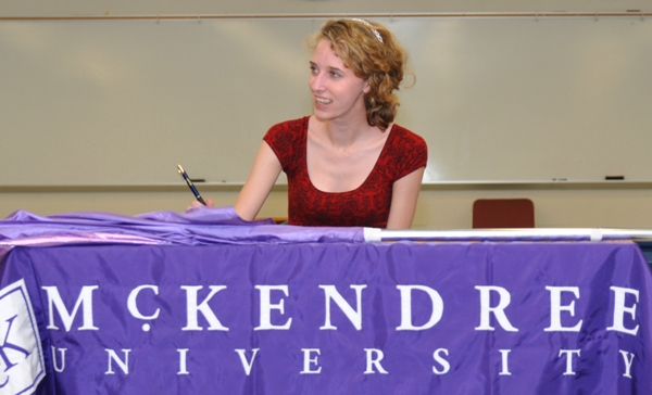 Gabrielle Zoellner signs a letter of intent in May 2014 to join the McKendree color guard. (Photo by Steve Bowman)