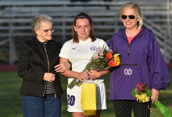 For senior night, Abby Harper stands with her grandmother Betty McDonald and mother Katrina McDonald.