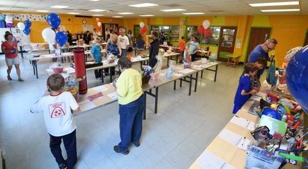 The silent auction is held in the cafeteria.