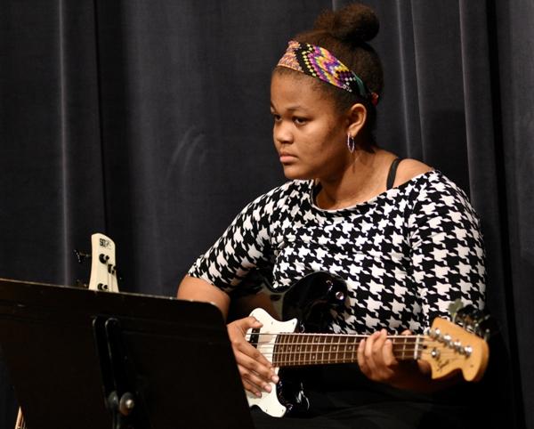 Eighth grade bass player Samira Bracey.
