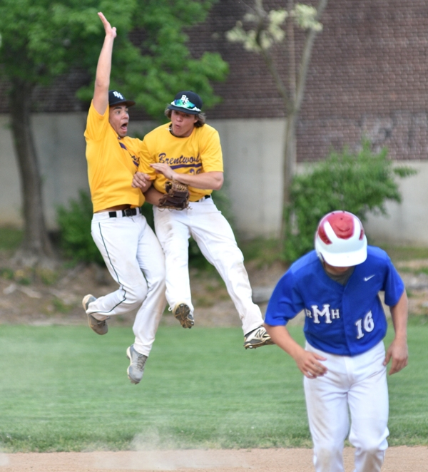 Brentwood's Mike Mills (left) and John Bischoff leap in celebration after the final out of Brentwood's 9-4 victory at MRH on April 28.
