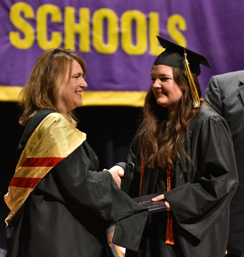 BHS teacher Christa Jones hands a diploma to her daughter Claudia.