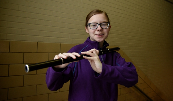 BHS freshman Caitlin Souers shows how she holds her Irish flute. It is made out of African blackwood. (Photo by Steve Bowman)