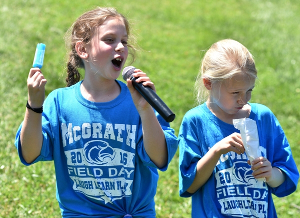 Anna Reese sings along with Penny Pop's music during a Popsicle break, while Kellie McGee waits her turn for the microphone.