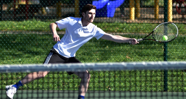 Alex Smoller plays a singles match against St. Mary's.