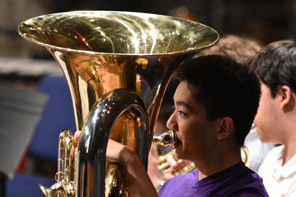 Xun Lu plays tuba for the high school band.