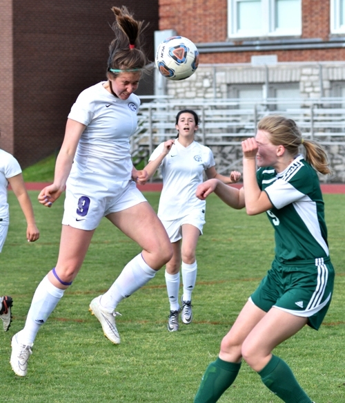 Gabby Gombas gets her head on the ball.