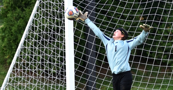 Logan Darrow makes a save in Brentwood's 3-2 home victory over Bayless on May 3. (All photos by Steve Bowman)