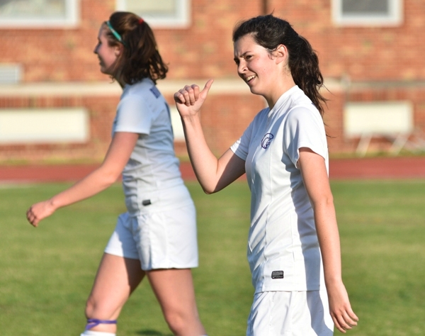 Amanda Ingersoll reacts to a compliment from a coach on the sideline.