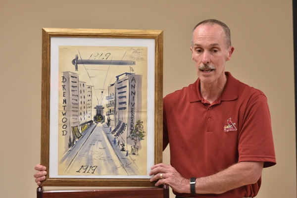 Dan Fitzgerald shows a painting that was recently found commemorating Brentwood's 50th anniversary in 1969.
