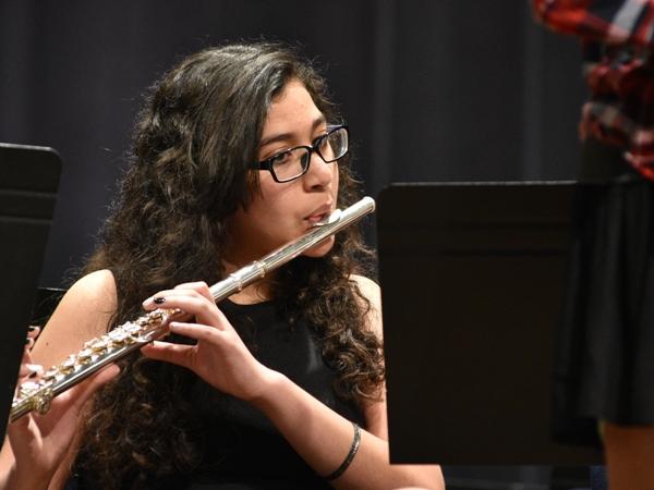 Maya Sabeh plays the flute.