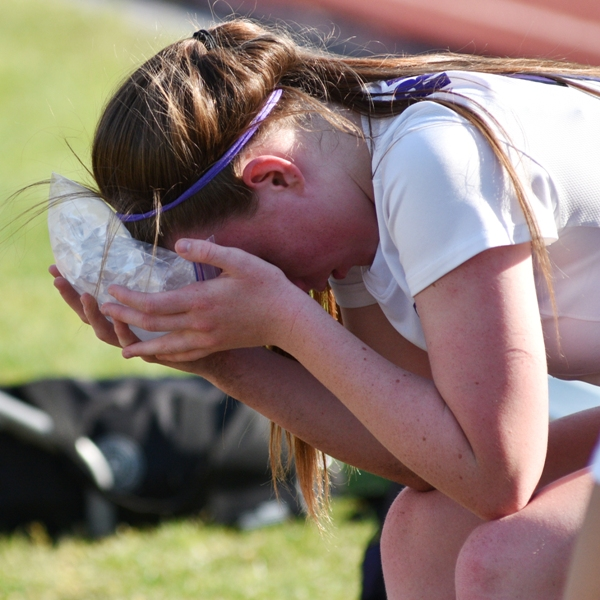 Maddie Dorenbusch ices her forehead after colliding with the Crossroads goalkeeper. The injury caused Dorenbusch to miss the final 25 minutes of the game.