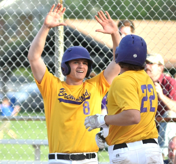 Skylar Sappington and John Bischoff are happy to cross home plate in the eighth