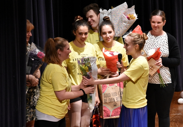 Amanda Fedor receives flowers and emotional thanks from students.