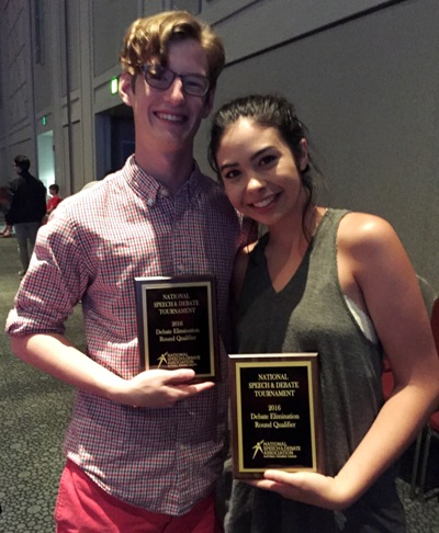 Saunders and Craren pose with the plaques they won at the NSDA district championships in March.