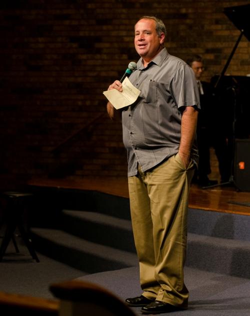 The Rock Church senior pastor Timothy Cowen introduces the choir.