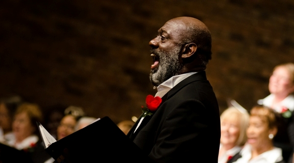 A soloist with the Community Gospel Choir sings on Saturday at the Rock Church of St. Louis. (Photo by David Bowman)